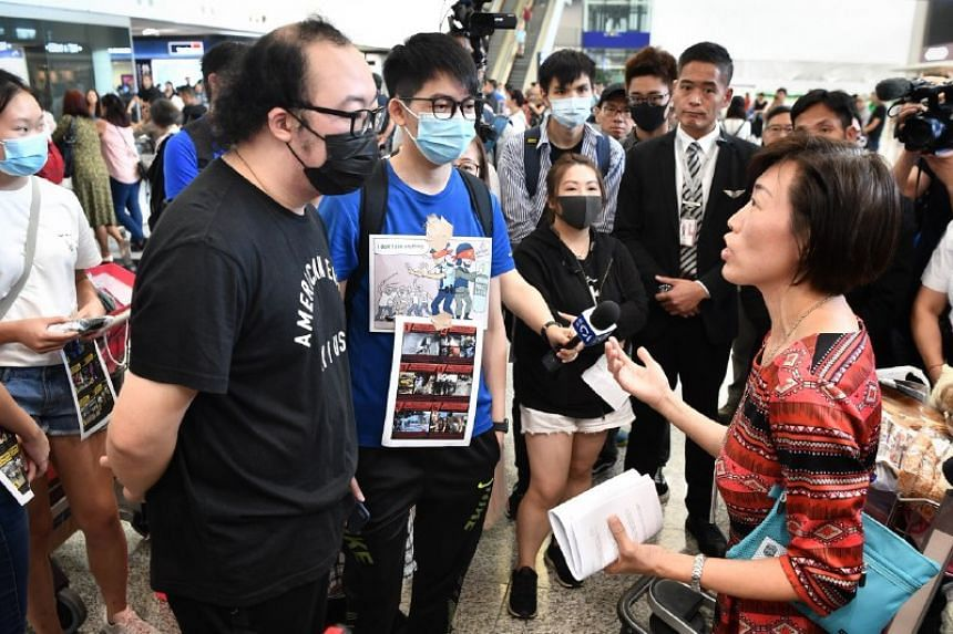 Officials asking protesters to leave at Hong Kong's international airport on July 30, 2019.