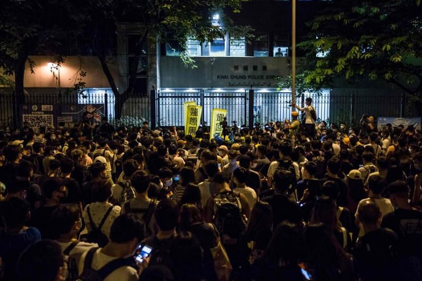 Protesters outside Kwai Chung police station in support of those detained with the charge of rioting during recent clashes in Hong Kong on July 30, 2019.