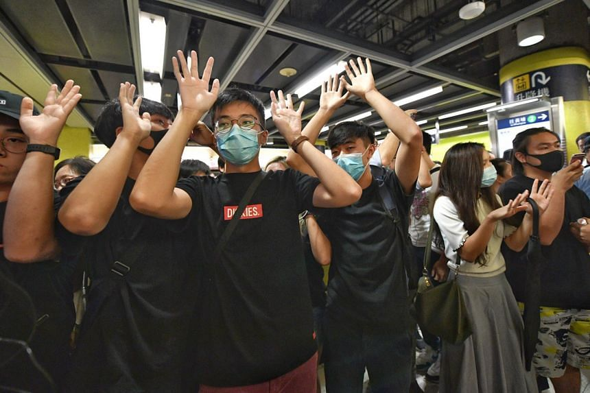 Protesters at Tiu Keng Leng Station in Sai Kung. Some turned up at the station at 7.50am to block the train doors with their hands, bodies or items.