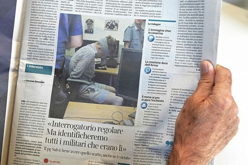 A man reads an Italian newspaper with the last news about the death of Carabinieri officer Mario Cerciello Rega.