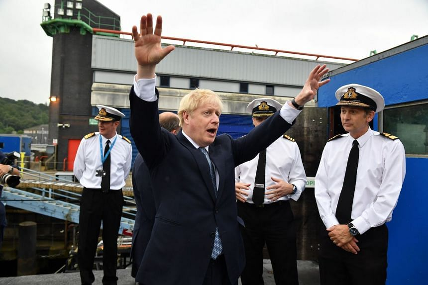 "British Prime Minister Boris Johnson visiting HMS Vengeance at HM Naval Base Clyde in Scotland yesterday. He is on a tour of Britain to announce new funding for so-called ""growth deals"" across Scotland, Wales and Northern Ireland, which provide i"