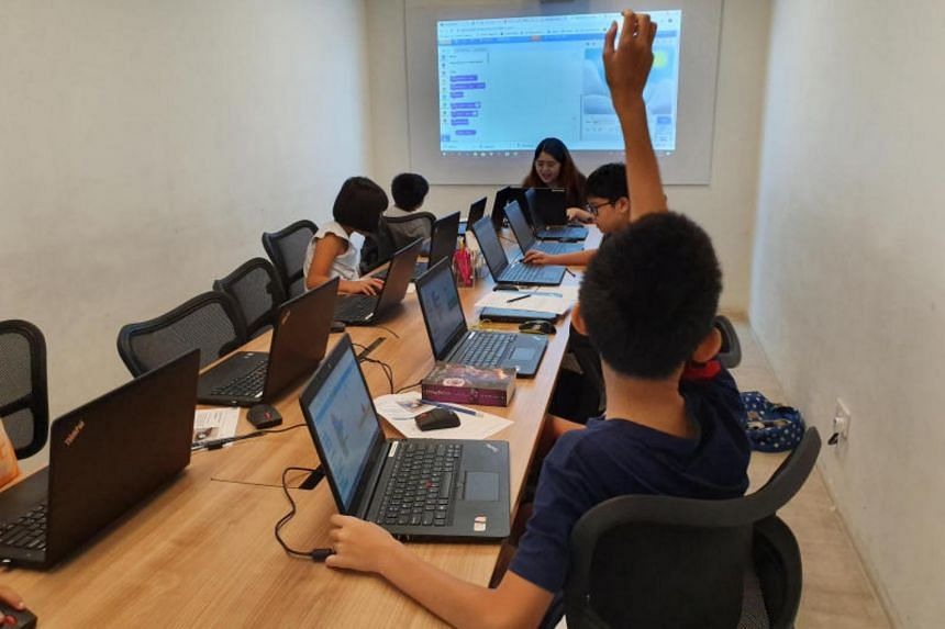 Children learning how to code using visual programming language Scratch at a coding enrichment school.