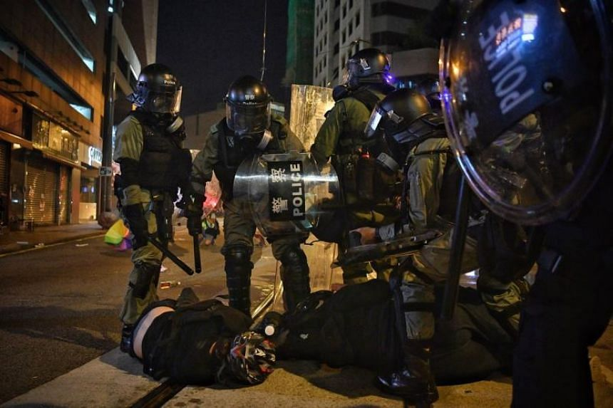 Hong Kong riot police detaining protesters in Sheung Wan on July 28, 2019.