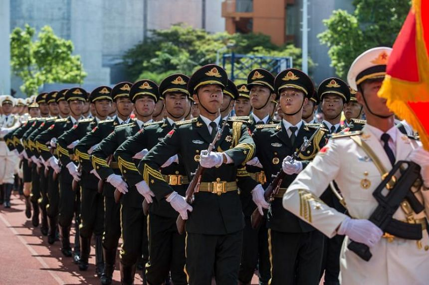 Soldiers of the Peoples' Liberation Army march during an open day at the Ngong Shuen Chau Barracks in Hong Kong on June 30, 2019.