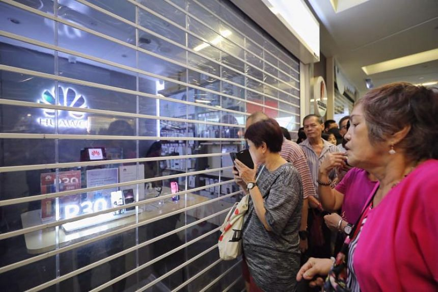 Members of the public seen outside the Huawei store at Nex shopping mall in Serangoon on July 26, 2019, the day a promotion for the Huawei Y6 Pro 2019 was supposed to begin.