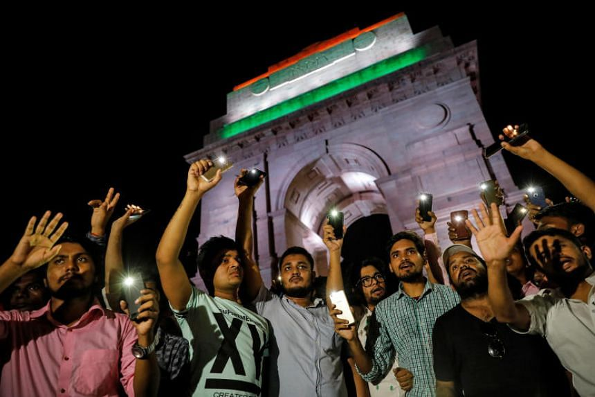 Protesters in New Delhi on July 29, 2019, demanding an investigation in a highway collision in which a woman who is fighting a rape case against a Bharatiya Janata Party legislator was critically injured.