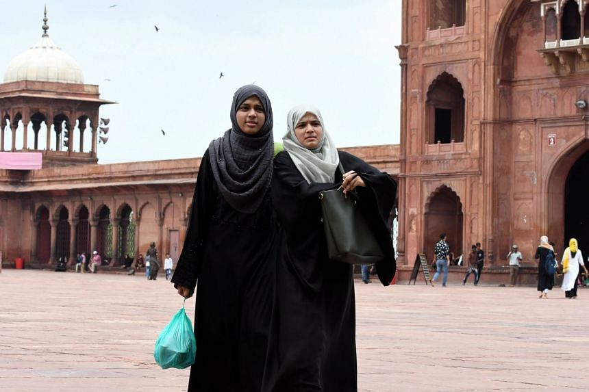 Indian Muslim women visiting the Jama Masjid in New Delhi.