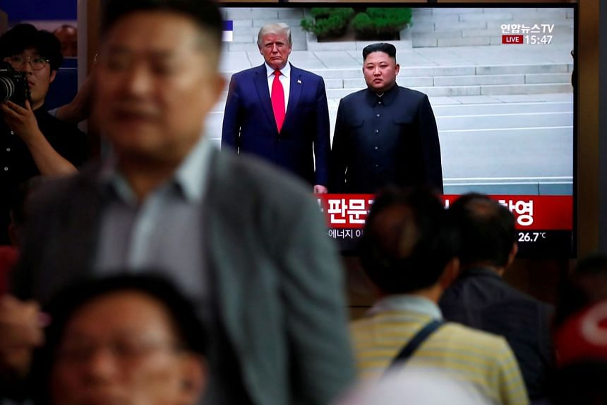 South Korean people watch a live TV broadcast on a meeting between North Korean leader Kim Jong Un and US President Donald Trump in June 2019.