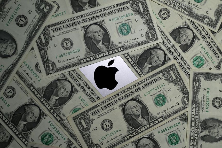 US dollar banknotes and the Apple logo are seen in this photo illustration.