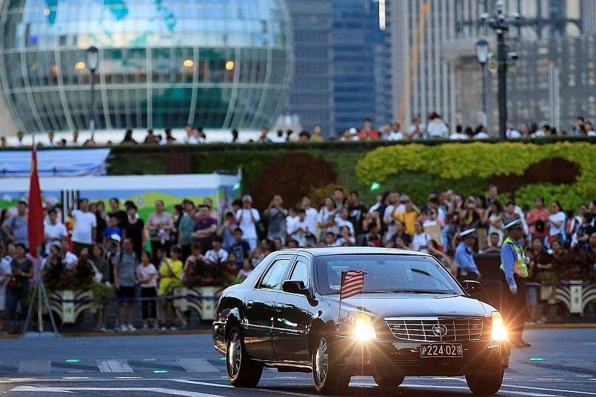 Above: The police moving the crowd ahead of the arrival of the US delegation, which includes Treasury Secretary Steven Mnuchin and Trade Representative Robert Lighthizer, in Shanghai yesterday. Below: A car with a US flag arriving at the Fairmont Pea
