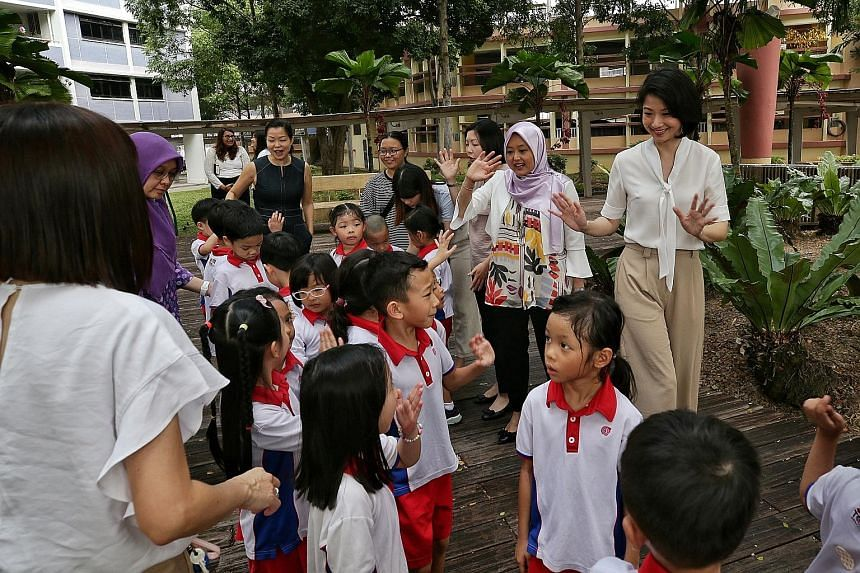 Senior Parliamentary Secretary Sun Xueling (far right) greeting PCF Sparkletots pre-schoolers in Fengshan yesterday with fellow PAP Women's Wing members (beside her, from right) Rahayu Mahzam, Cheryl Chan, Cheng Li Hui (in black dress) and Intan Azur