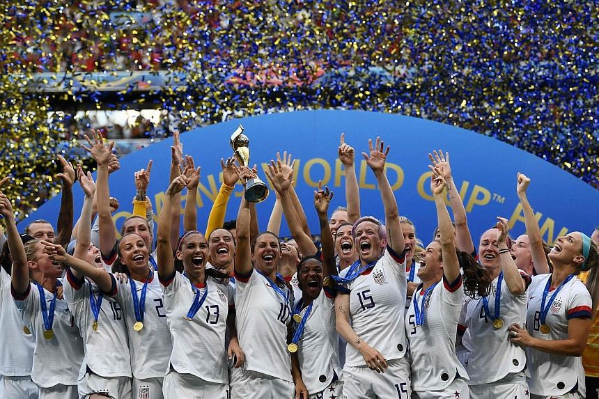 US co-captain Carli Lloyd raising the Women's World Cup trophy as the team celebrated after beating the Netherlands 2-0 in the final on July 7 in Lyon, France. It was the country's record fourth title.