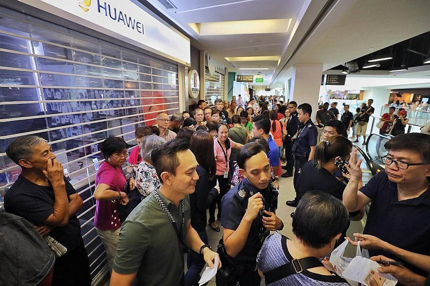 A crowd (left) outside the Huawei store at Nex mall last Friday. Police had to be called in at many outlets to manage the angry crowds. The promotion was cut short when the 27 stores selling the Y6 Pro sold out almost immediately (above), in some cas