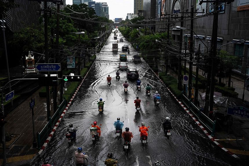 A flooded Bangkok street after heavy rain last month. Other parts of the country experienced the worst drought in years and led the authorities to cut estimates for crop production. Cloud-seeding planes have been deployed, and pumps and trucks have b