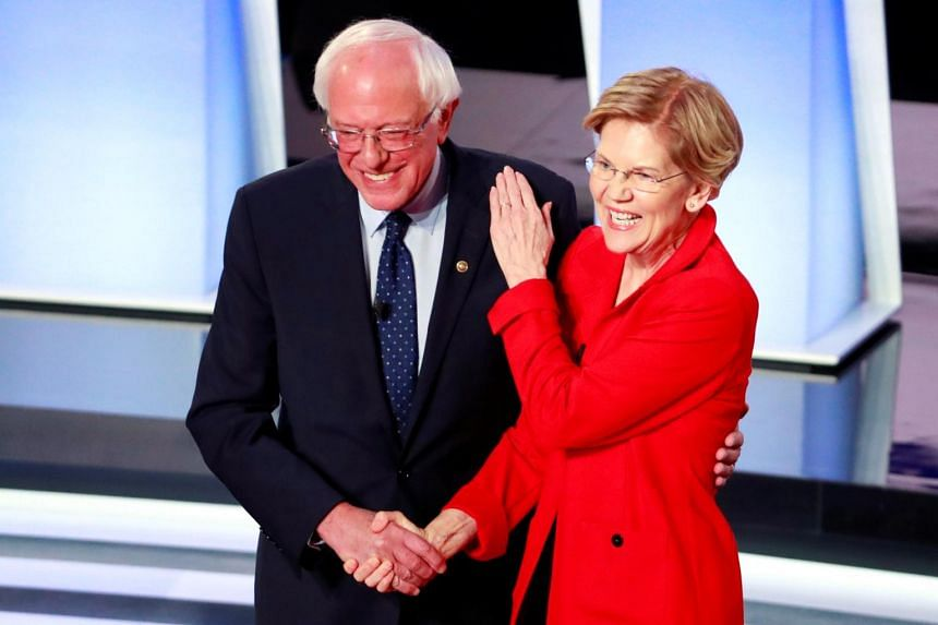US Senator Bernie Sanders and US Senator Elizabeth Warren shake hands before the start of the first night of the second 2020 Democratic US presidential debate on July 30, 2019.