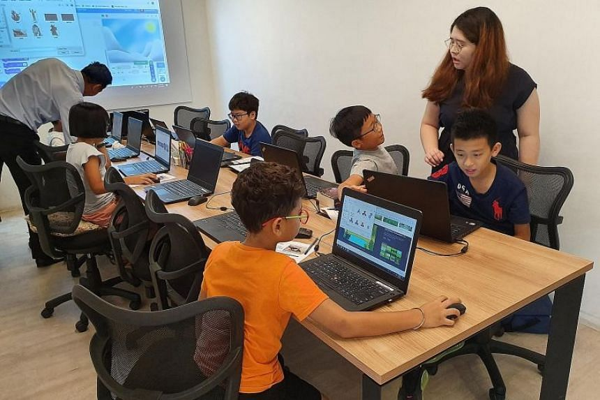 Children as young as seven learning to code using visual programming language Scratch at Coding Lab.