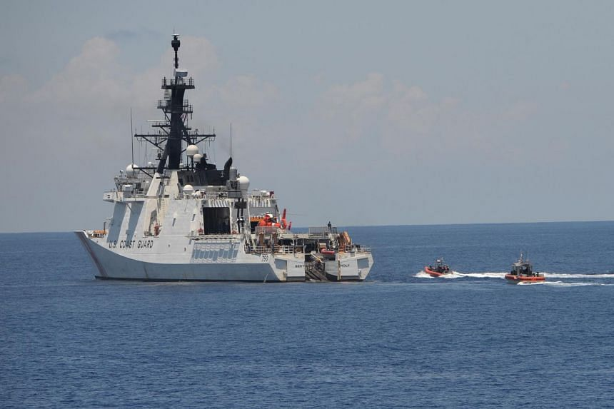 US coastguard ship Bertholf maneouvers during a joint exercise with their Philippine counterpart near Scarborough shoal in the South China Sea on May 14, 2019.