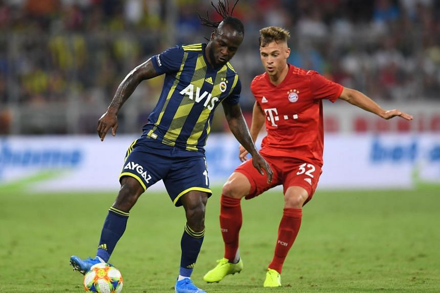 Midfielders Joshua Kimmich (right) and Nabil Dirar (left) vie for the ball during the Audi Cup football match between Bayern Munich and Fenerbahce in Munich, on July 30, 2019.