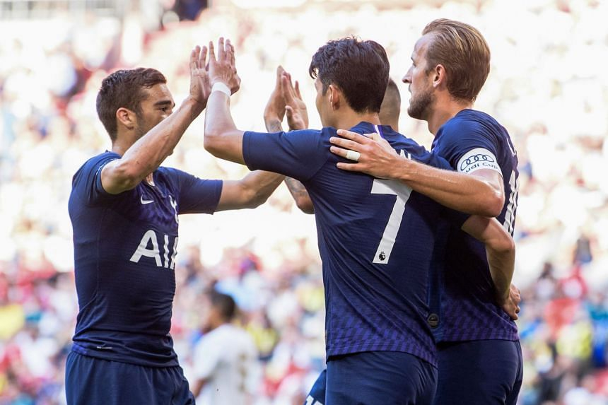 Kane (eight) celebrates scoring Spurs' first goal with team mates Harry Winks (left) and Heung-min Son.