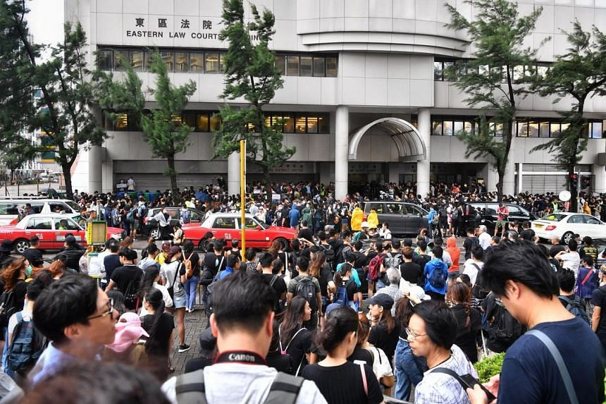 Hundreds gather outside the Eastern Law Courts Building in solidarity with those charged on July 31. Rioting carries a jail term of up to 10 years.