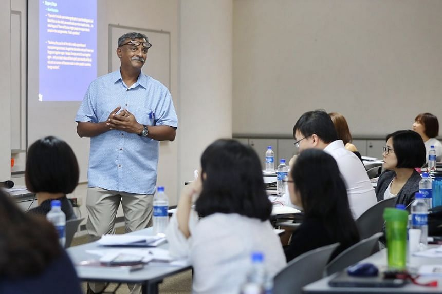 Veteran media professional Geoffrey Pereira conducting The Straits Times Media Analysis Course at the Singapore Press Holdings News Centre on July 31, 2019.