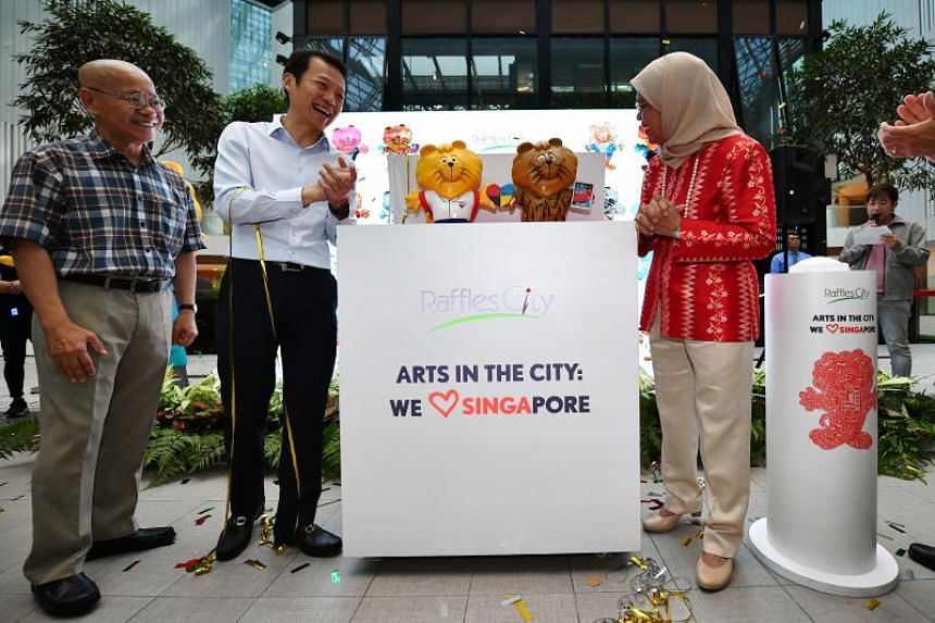 (From left) Dr William Wan, general secretary of the Singapore Kindness Movement, Mr Lee Chee Koon, Group CEO and director of CapitaLand Group, and President Halimah Yacob at the launch of Arts in the City: We Love SINGApore on July 31, 2019.