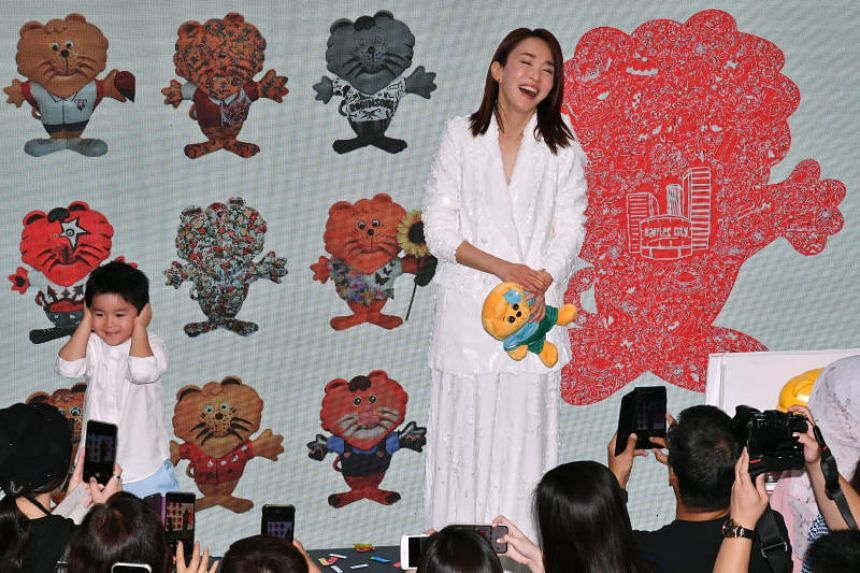 Local celebrity Fann Wong and her son at the launch of Arts in the City: We Love SINGApore.