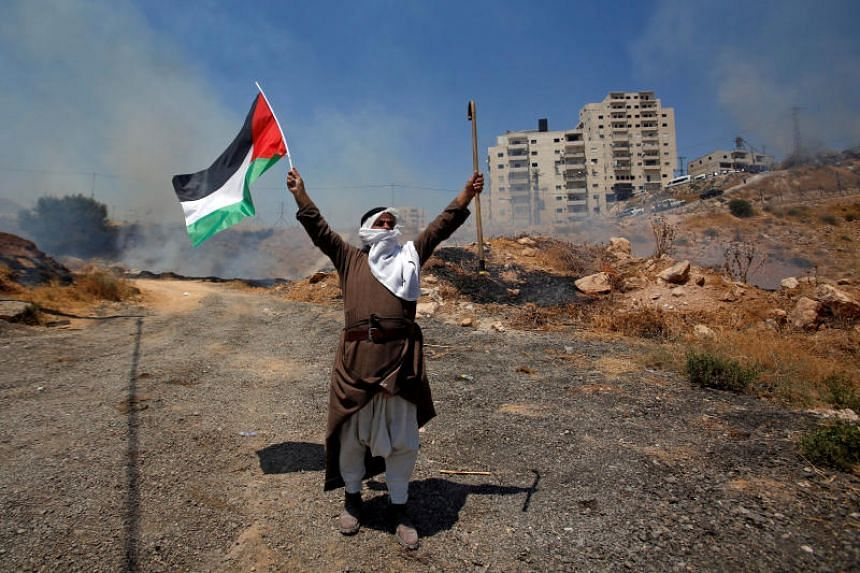 A demonstrator protests against the Israeli demolitions of Palestinian homes in the village of Sur Baher, which sits on either side of the Israeli barrier in East Jerusalem and the Israeli-occupied West Bank, on July 26, 2019.