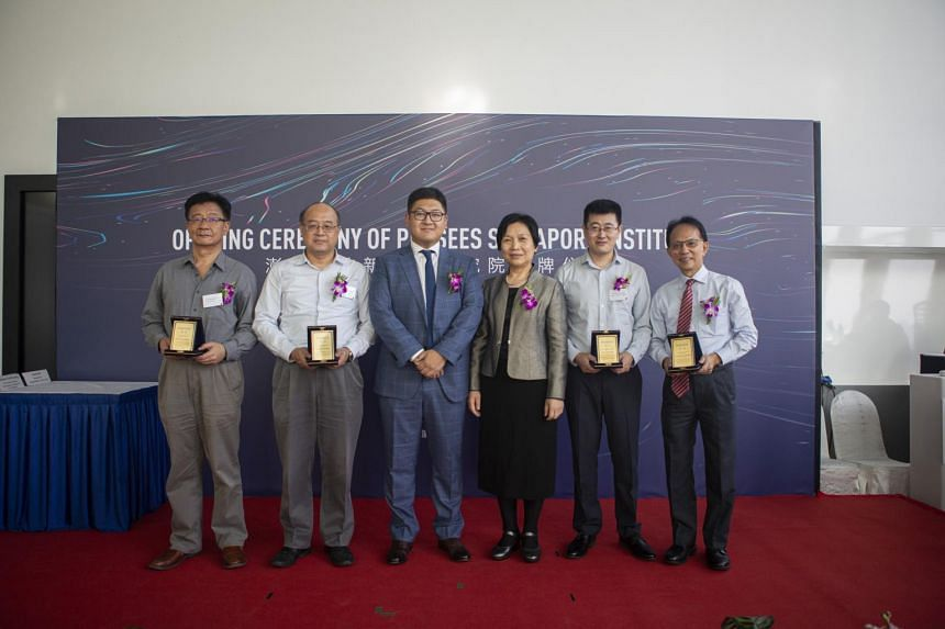 (From left) Professor Jiang Xudong, School of Electrical and Electronic Engineering, Nanyang Technological University (NTU);  Professor Cheng I-Ming, School of Mechanical  and Aerospace Engineering, NTU; Mr Ma Yuan, founder and chief executive office