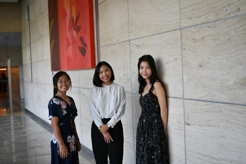 Singapore Press Holdings journalism scholarship holders (from left) Goh Ruoxue, 19, Tan Yu Jia, 22, and Christie Chiu, 19.