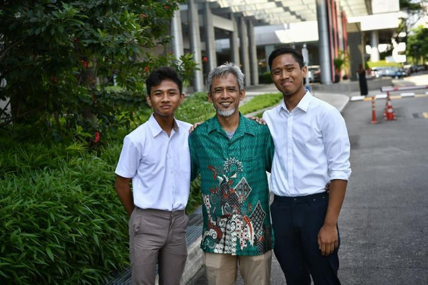 Mr Abdullah Harun, who has been working in SPH's printing press section for 32 years, saw his sons, Muhammad Irfan (left), 17, receiving a junior college scholarship, and Muhammad Rusyaidi, 18, receiving a polytechnic scholarship.