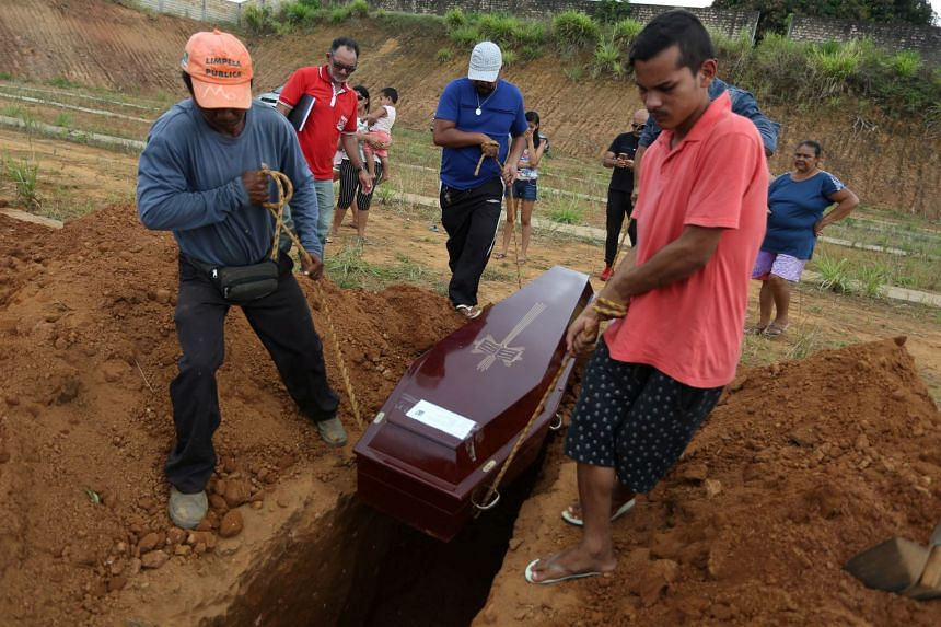Relatives attend the funeral of one of the inmates who died during the riot..