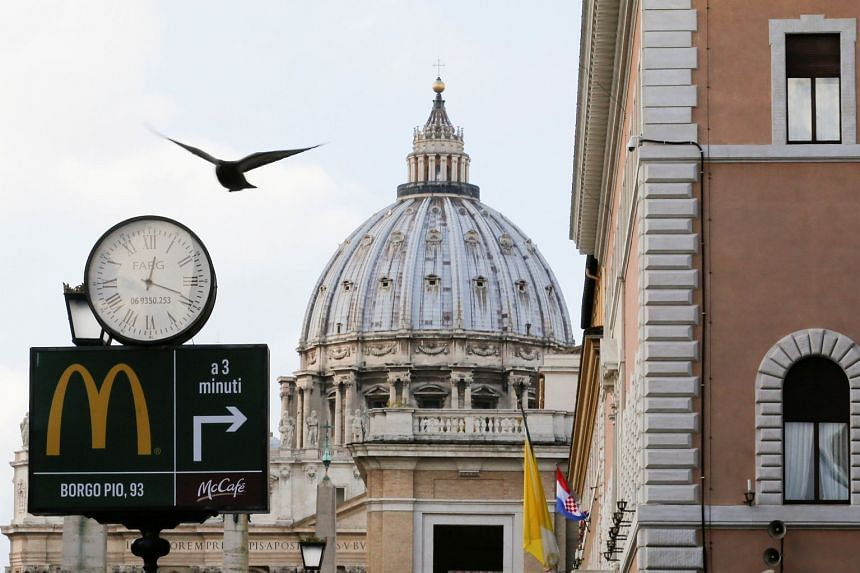 A McDonald's sign is seen on Via della Conciliazione street in Rome in front of the Vatican City's St Peter's Square.