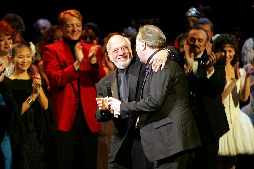 Director Harold Prince (left) and composer Andrew Lloyd Webber greet one another during the curtain call of The Phantom Of The Opera in New York City in 2006
