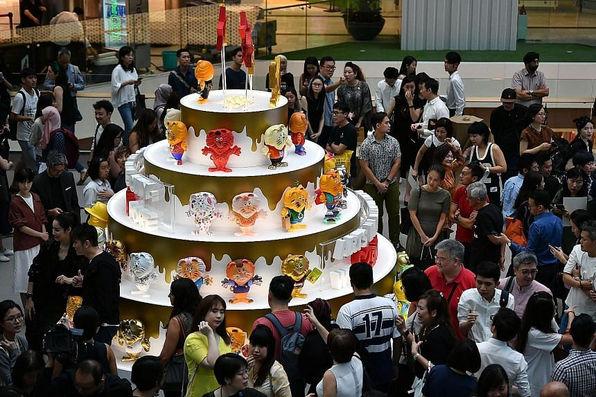 President Halimah Yacob spoke on the sidelines of an exhibition showing 200 figurines of Singa the lion at Raffles City shopping mall yesterday.