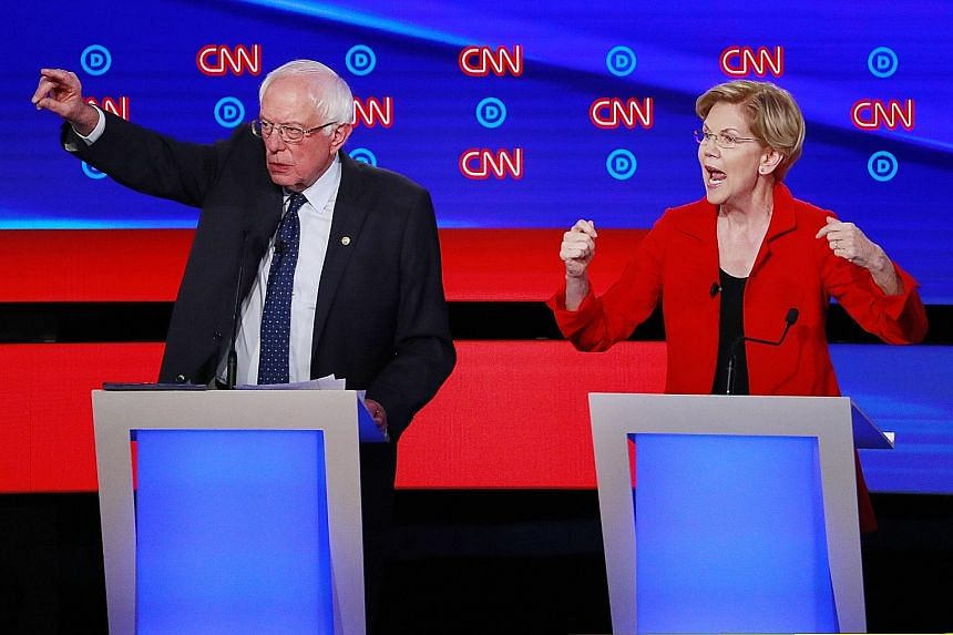 United States senators Bernie Sanders and Elizabeth Warren had vowed not to attack each other at Tuesday's debate, but often found themselves teaming up to defend policy positions they share instead of drawing contrasts. PHOTO: REUTERS