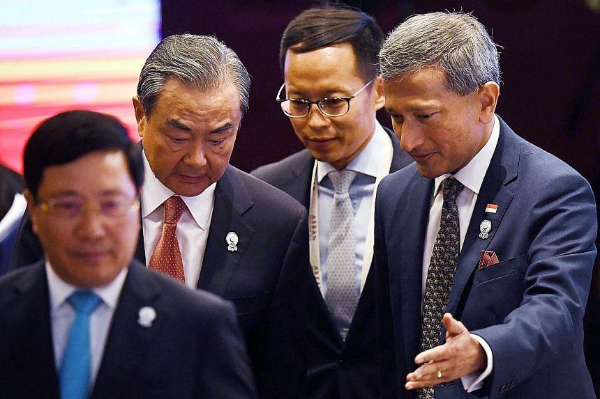 Foreign Minister Vivian Balakrishnan and China's Foreign Minister Wang Yi at the Asean-China Ministerial Meeting in Bangkok yesterday. PHOTO: AGENCE FRANCE-PRESSE