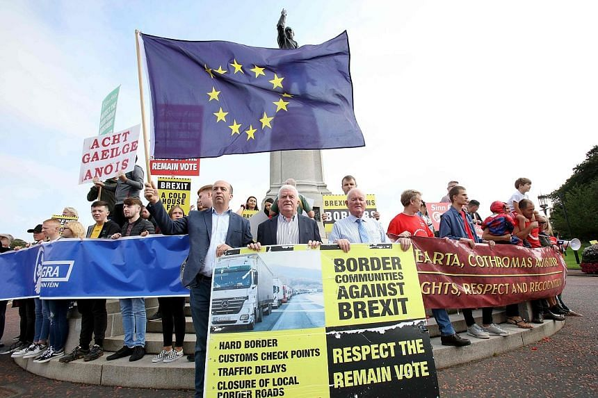 """Anti-Brexit demonstrators outside Stormont House during Britain's Prime Minister Boris Johnson's visit to Belfast yesterday. Mr Johnson held talks in a bid to untangle an impasse over the Irish border """"backstop"""" that has scuppered efforts to secure a"""