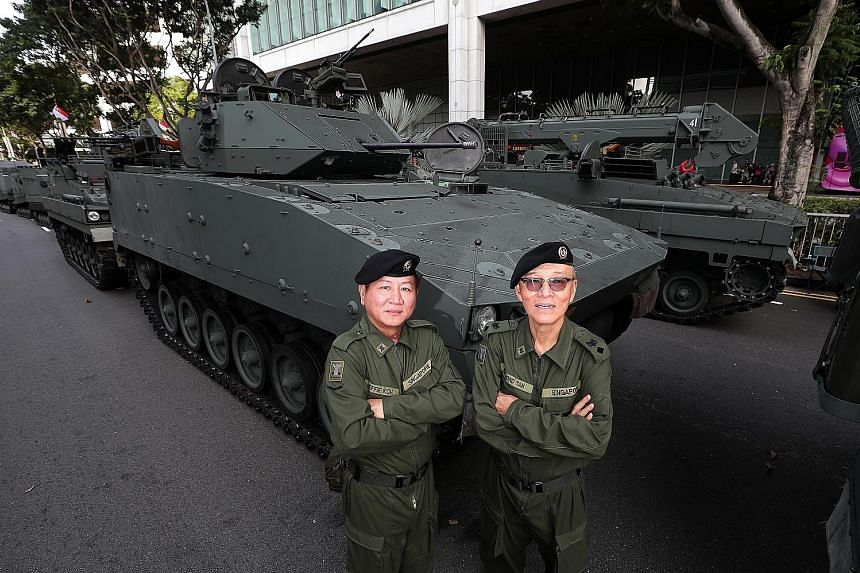 Friends for more than 40 years, retired Lieutenant-Colonel Raymond Tan (right), 68, and former national serviceman Jeffie Koh, 60, will be in the same vehicle during this year's parade.