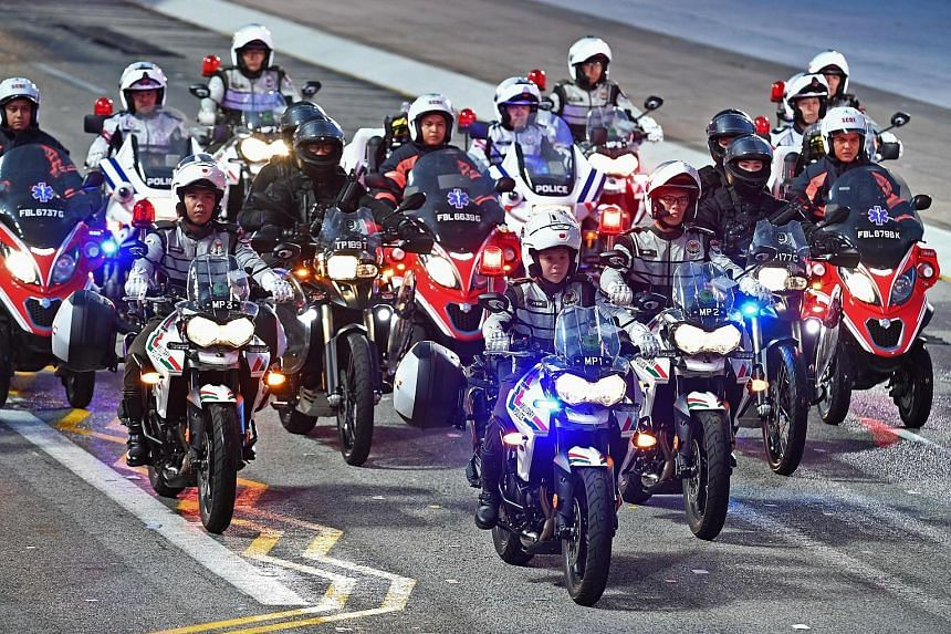 First Sergeant Soh Jia Yu leading the 21-bike contingent, which consists of riders from the Singapore Armed Forces, Traffic Police, Rapid Deployment Troops under the police, and the Singapore Civil Defence Force, during a preview of the National Day