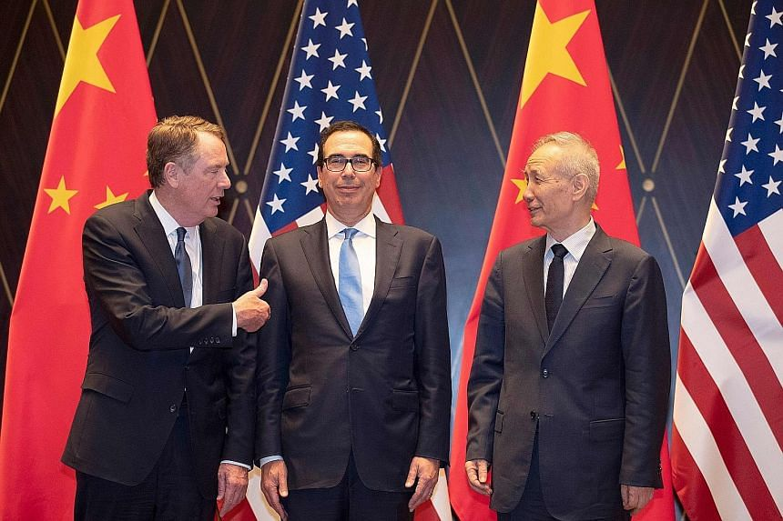 (From far left) US Trade Representative Robert Lighthizer, US Treasury Secretary Steven Mnuchin and Chinese Vice-Premier Liu He at the Xijiao Conference Centre in Shanghai yesterday. PHOTO: AGENCE FRANCE-PRESSE