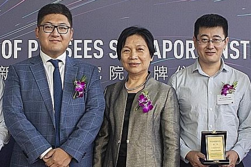 (From far left) Pensees founder and chief executive Ma Yuan, Pensees managing director and chief scientist Jane Shen and Dr Feng Jiashi of the National University of Singapore at the unveiling of Pensees Singapore Institute yesterday.