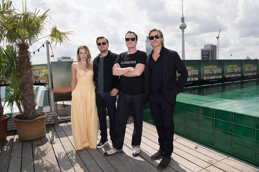(From left) Australian actress Margot Robbie, US actor Leonardo DiCaprio, US director Quentin Tarantino and US actor Brad Pitt pose for a photo in Berlin.