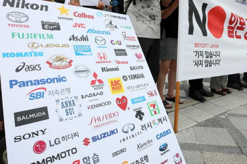 Civic activists hold a protest as part of a boycott campaign against Japanese goods in front of a branch of Uniqlo, a Japanese casual wear retailer, in Sejong, South Korea, July 18, 2019. The campaign arose after the Japanese government announced res