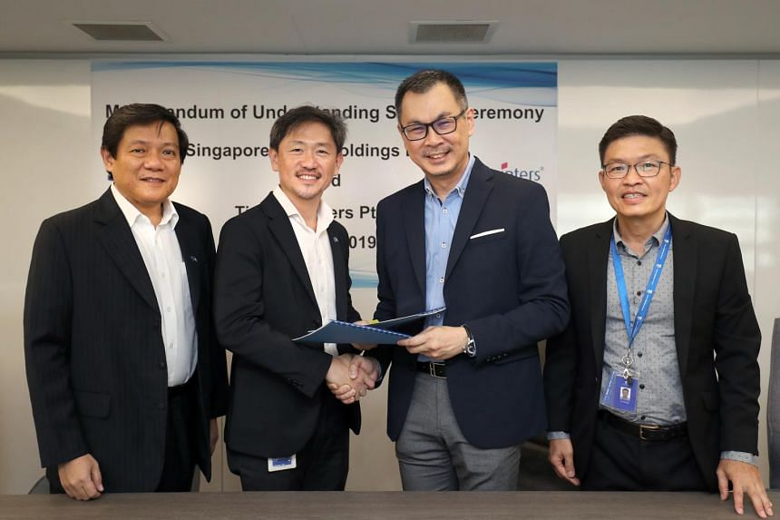 (From left) SPH senior vice-president of production Lim Swee Yeow, SPH deputy CEO Anthony Tan, Times Publishing Group CEO Siew Peng Yim and Times Publishing Group Head Printing Group & Strategic Development Tan Chin Sing at the MOU signing on July 31