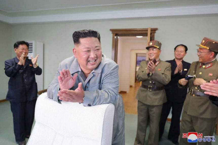 North Korean leader Kim Jong Un claps after watching a missile launch on July 25, 2019.