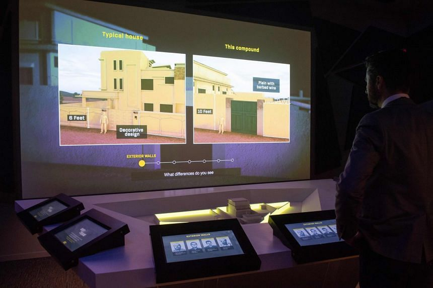 A visitor participates in an interactive exhibit in Washington about the raid to kill Al-Qaeda leader Osama Bin Laden at his Pakistan compound (pictured).