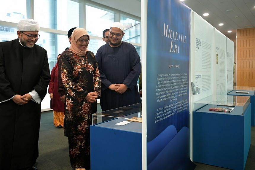 The exhibition, Treasures Of Muslim Scholars: 100 Years Of Singapore Literary Heritage, was launched by President Halimah Yacob (centre) at the National Library Building on Aug 1, 2019.