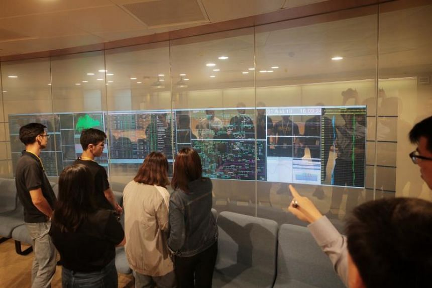 Polytechnic students view the energy nerve centre from a viewing gallery, during The Powering Lives Trail at Energy Market Authority's Power System Control Centre, on Aug 1, 2019.