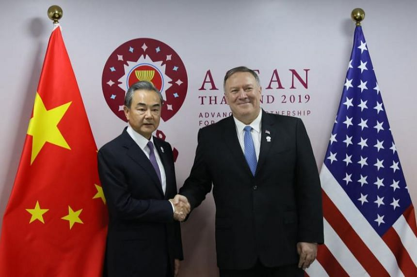 Senior Chinese diplomat Wang Yi (left) and US Secretary of State Mike Pompeo met and discussed how to promote stable bilateral relations on Aug 1, 2019.